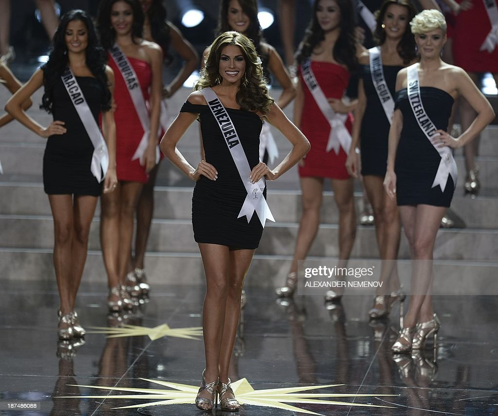 Miss Venezuela Gabriela Isler (C) competes during the 2013 Miss Universe competition in Moscow on November 9, 2013. Gabriela Isler, a 25-year-old Venezuelan television presenter, was crowned Miss Universe in Moscow in a glittering ceremony. Judges including rock star Steven Tyler from Aerosmith picked the winner from a total of 86 contestants at the show, watched by several billion viewers around the world. AFP PHOTO / ALEXANDER NEMENOV