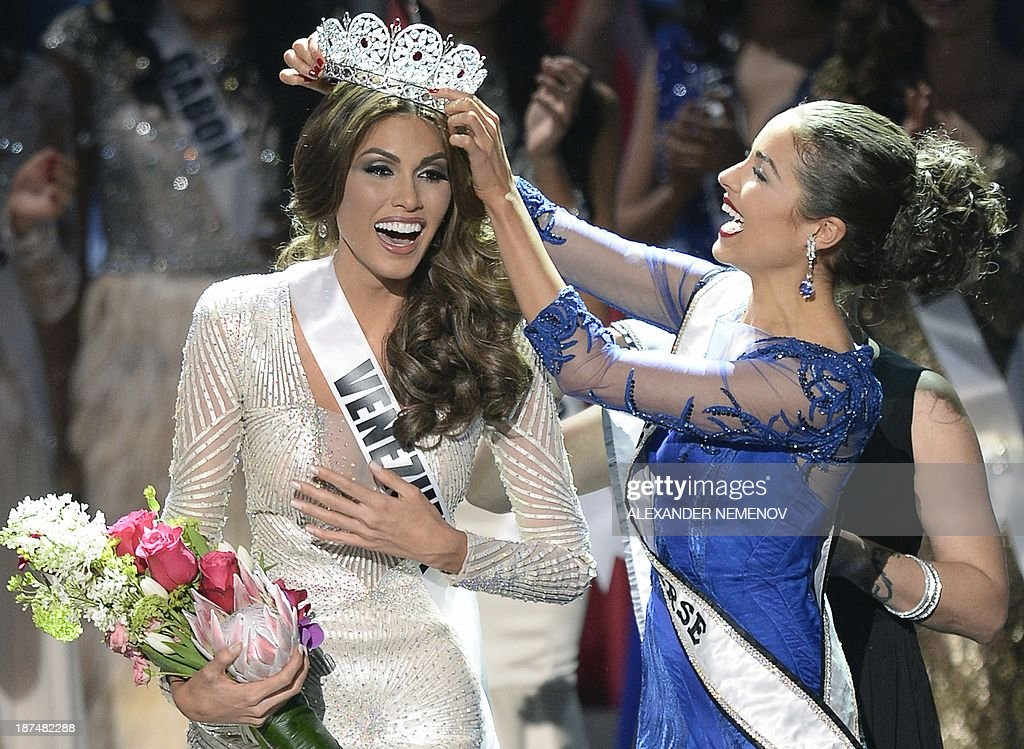 Miss Venezuela Gabriela Isler (L) reacts as she receives her crown during the 2013 Miss Universe competition in Moscow on November 9, 2013. Gabriela Isler, a 25-year-old Venezuelan television presenter, was crowned Miss Universe in Moscow in a glittering ceremony. Judges including rock star Steven Tyler from Aerosmith picked the winner from a total of 86 contestants at the show, watched by several billion viewers around the world.