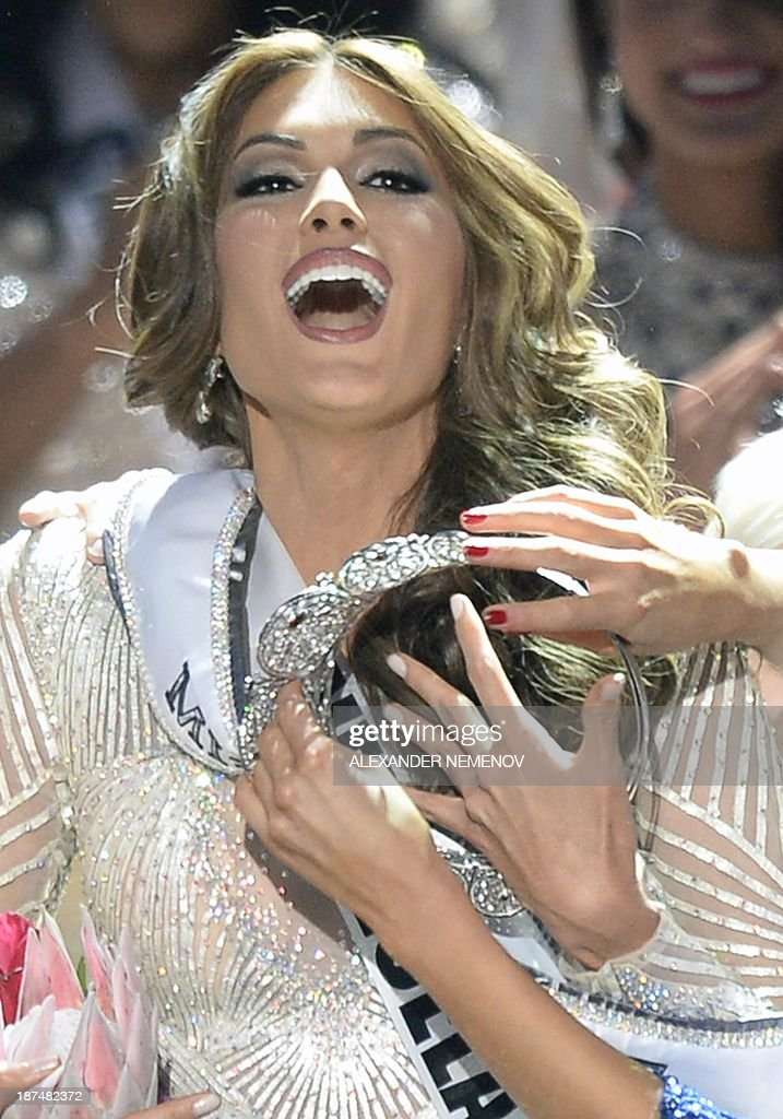 Miss Venezuela Gabriela Isler reacts as she receives her crown during the 2013 Miss Universe competition in Moscow on November 9, 2013. Gabriela Isler, a 25-year-old Venezuelan television presenter, was crowned Miss Universe in Moscow in a glittering ceremony. Judges including rock star Steven Tyler from Aerosmith picked the winner from a total of 86 contestants at the show, watched by several billion viewers around the world.