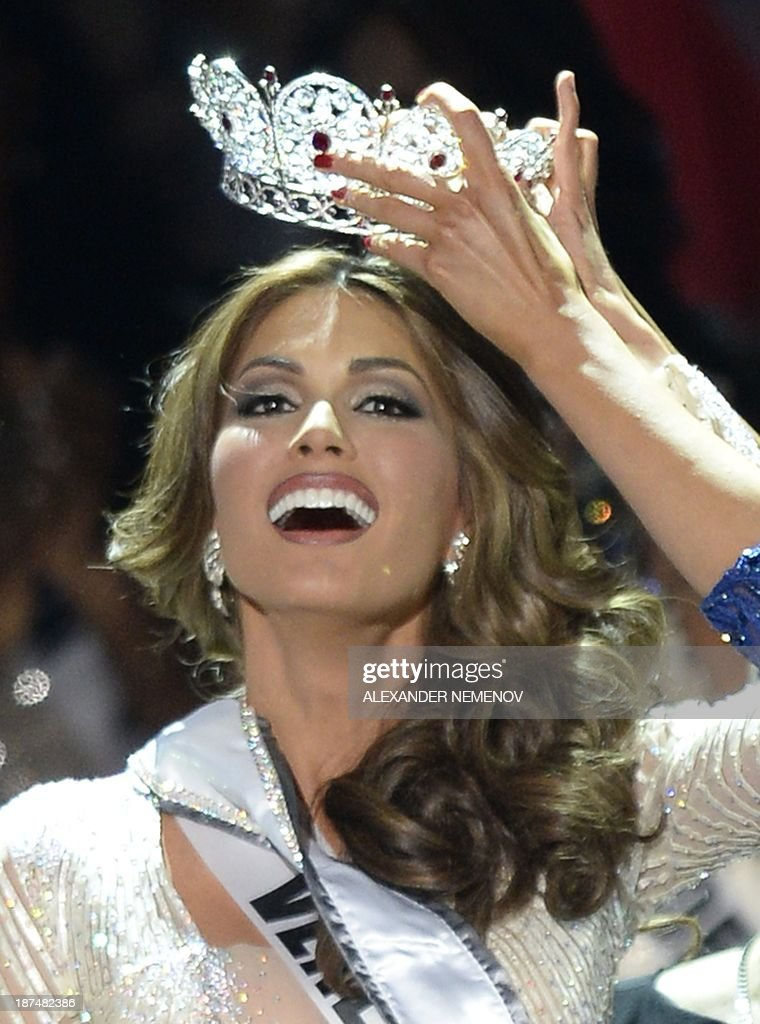 Miss Venezuela Gabriela Isler reacts as she receives her crown during the 2013 Miss Universe competition in Moscow on November 9, 2013. Gabriela Isler, a 25-year-old Venezuelan television presenter, was crowned Miss Universe in Moscow in a glittering ceremony. Judges including rock star Steven Tyler from Aerosmith picked the winner from a total of 86 contestants at the show, watched by several billion viewers around the world. AFP PHOTO / ALEXANDER NEMENOV