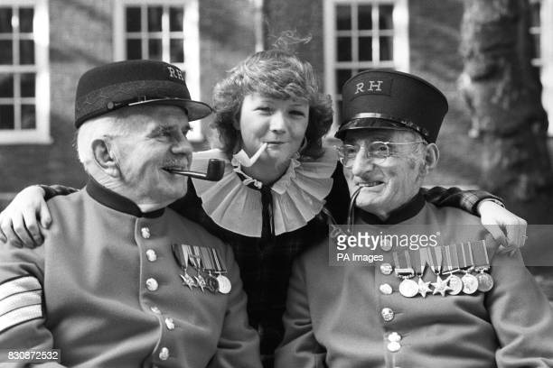 Miss Wendy Rogers of Dagenham with Chelsea Pensioners Sgt Fred Cook of Salisbury and CSM Alan Aris Norwich enjoying a pipe smoking session when they...