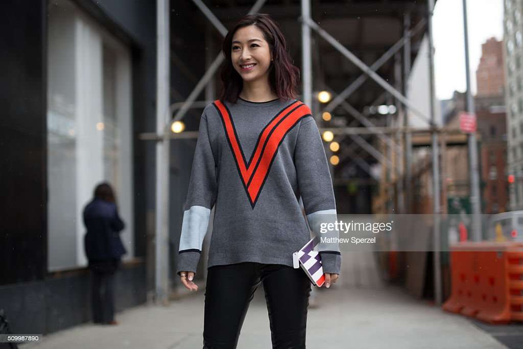Miss Wenya is seen at Lacoste wearing Lacoste sweater & clutch and Dior shoes during New York Fashion Week: Women's Fall/Winter 2016 on February 13, 2016 in New York City.