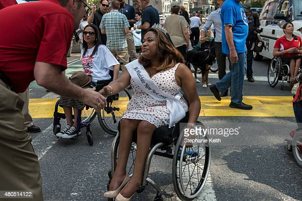 Miss Wheelchair New York greets a supporter at the first annual Disability Pride Parade on July 12 2015 in New York City The parade calls attention...