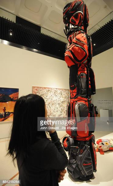 Miss WingSie Chan a Curatorial Intern at the Barbican Art Gallery in the City of London studies the Brian Jungen inspired Golf Bags collection an...