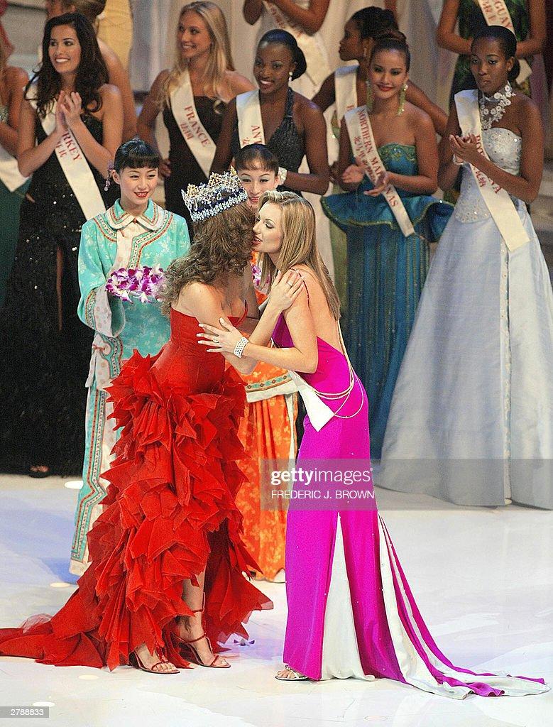 Miss World 2003 winner Rosanna Davison of Ireland (R) is congratulated ...