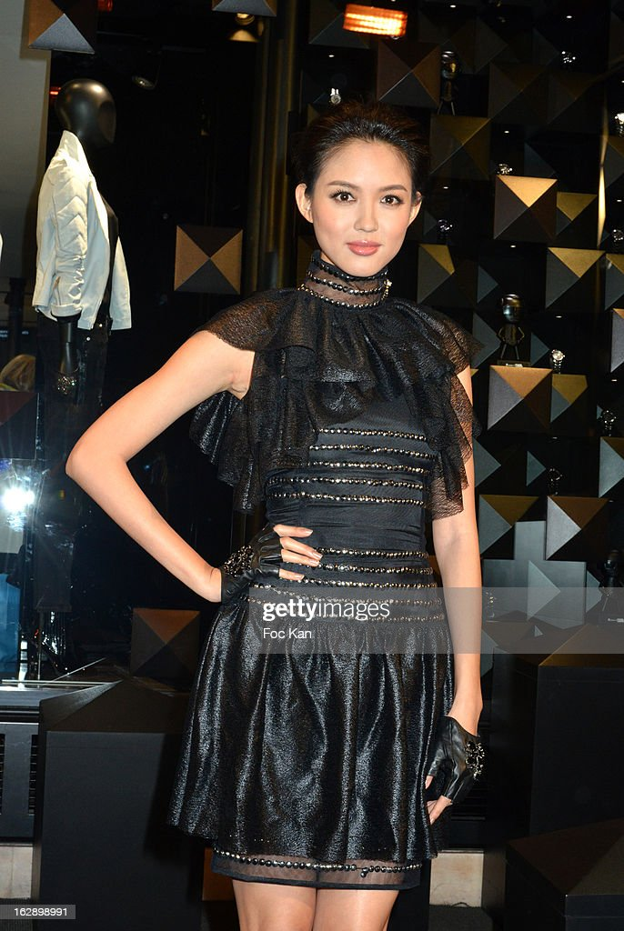 Miss World 2007 Zhang Zilin attends the opening of the Karl Lagerfeld concept store during Paris Fashion Week Fall/Winter 2013 at Karl Lagerfeld Concept Store Saint Germain on February 28, 2013 in Paris, France.