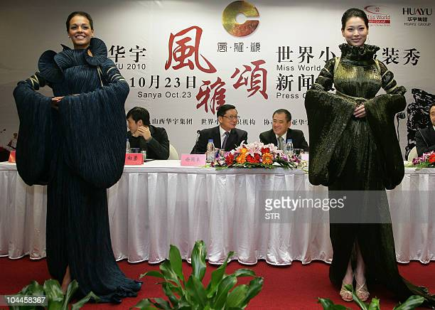 Miss World 2009 Kaiane Aldorino of Gibraltar and Miss China 2010 Tang Xiao dress in costumes as they pose during a press conference in Beijing on...