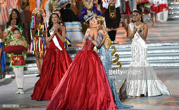 Miss World 2014 Rolene Strauss hugs the new winner Mireia Lalaguna Rozo of Spain during the Miss World Grand Final on December 19 2015 in Sanya...