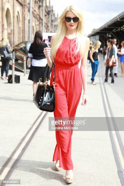 Miss World Australia Erin Holland wearing a Shieke jumpsuit Chanel sunglasses and Tony Bianco shoes at MercedesBenz Fashion Week Australia 2014 at...