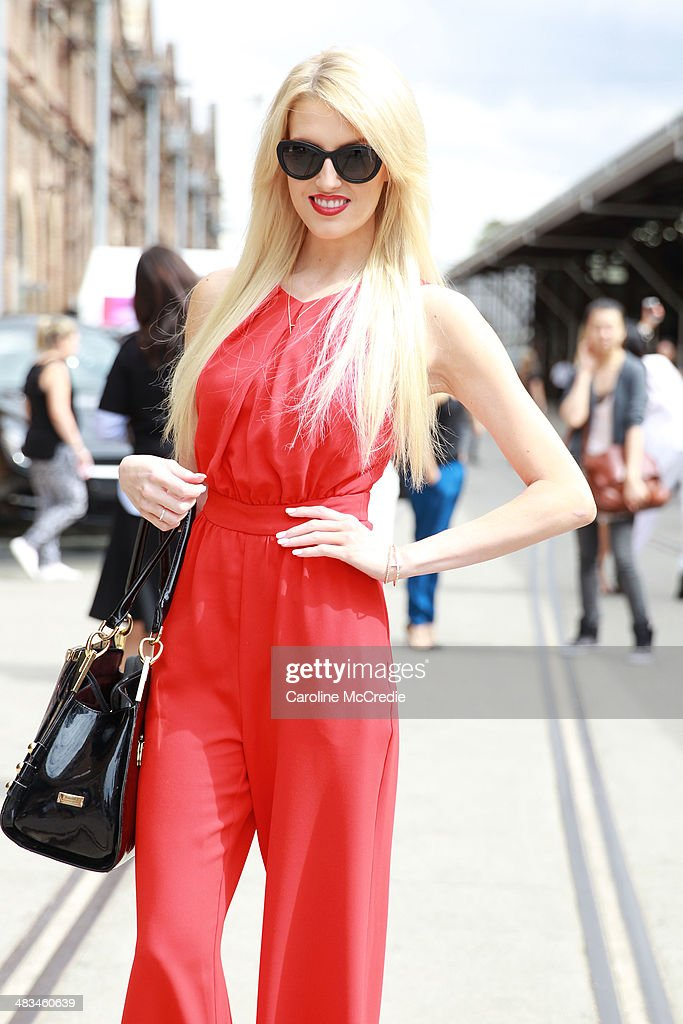 Miss World - Australia Erin Holland wearing a Shieke jumpsuit, Chanel sunglasses and Tony Bianco shoes at Mercedes-Benz Fashion Week Australia 2014 at Carriageworks on April 9, 2014 in Sydney, Australia.