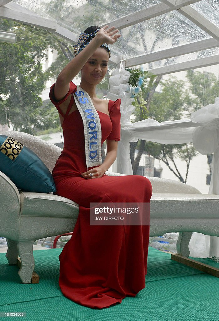 Miss World contest winner Megan Young of the Philippines waves to the crowd at a welcoming parade in Manila on October 11, 2013. The triumph of 23-year-old Megan Young was the main headline in major newspapers, who noted that it finally gave the Philippines a winner in all major beauty pageants after several victories in the Miss Universe and Miss International contests. AFP PHOTO / Jay DIRECTO