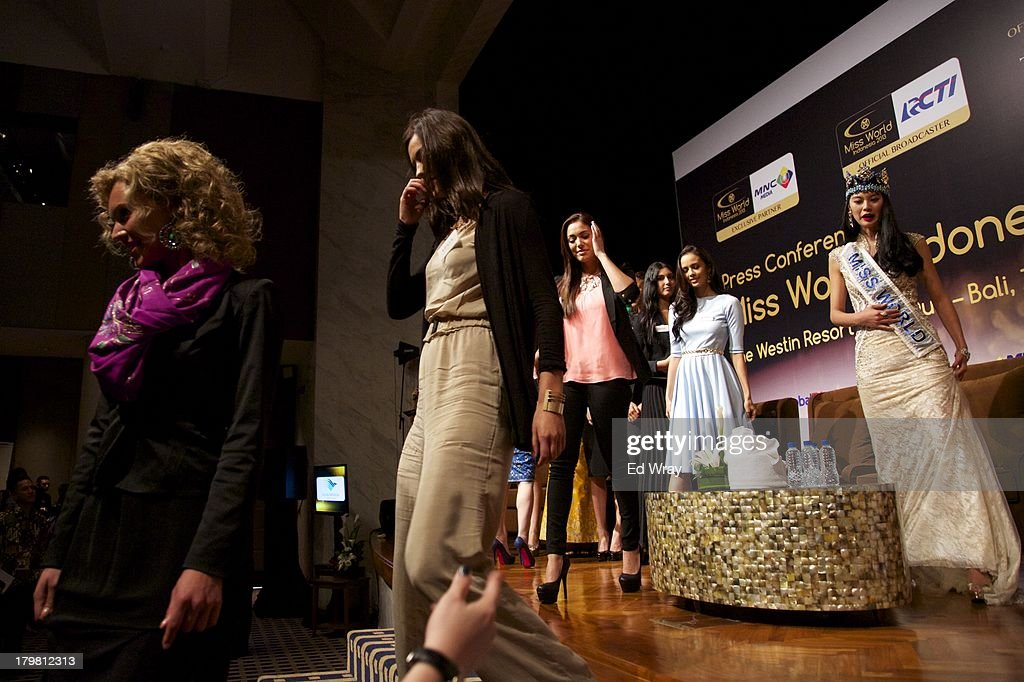 Miss World contestants from left to right: Miss Netherlands, Miss Spain, Miss Puerto Rico, Miss Philippines, and Miss World 2012 China's Wenxia Yu leave the stage after the opening press conference during the 2013 Miss World Pageant on September 7, 2013 in Denpasar, Bali, Indonesia. The Miss World contest has been protested by conservative Indonesian Muslim groups who object particularly to the Bikini swimwear portion of the competition which organizers have agreed to replace this year with a more modest beachwear competition including tradtional Indonesian batik sarongs.