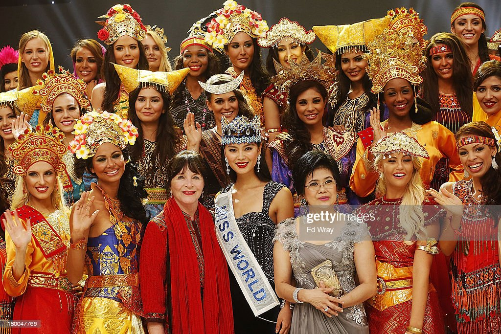 Miss World contestants pose for a photo wearing traditional Indonesian Dress during the Miss World 2013 Indonesia opening show on September 8, 2013 in Nusa Dua, Indonesia. Indonesia's government has moved the final round of the Miss World pageant from main Java island to the resort island of Bali due to the ongoing Muslim protests.