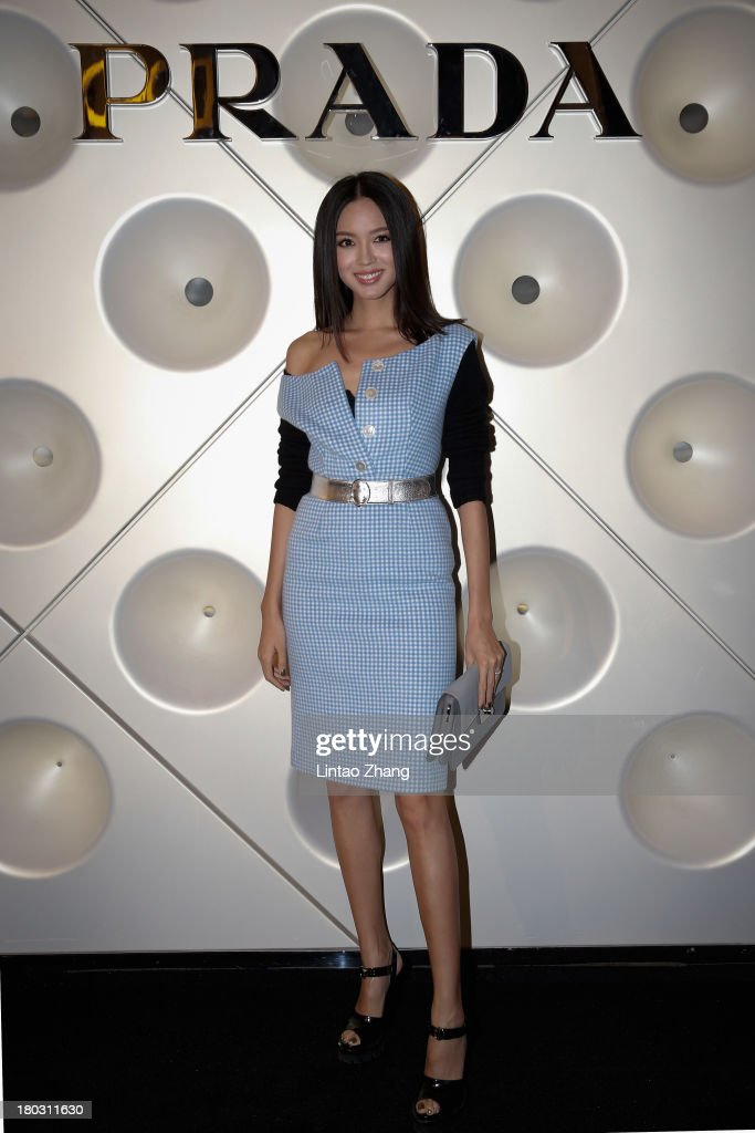 Miss World Zhang Zilin attends Miuccia Prada and Catherine Martin Dress Gatsby Exhibition in Prada store on September 10, 2013 in Shanghai, China.