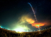 Missile launch at night. Fish eye lens. The elements of this image furnished by NASA.