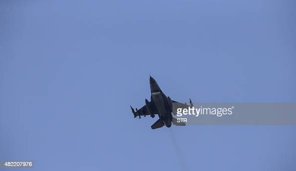 A missileloaded Turkish Air Force warplane takes off from the Incirlik Air Base in the outskirts of the city of Adana southeastern Turkey on July 28...