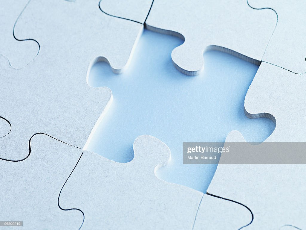 Missing jigsaw puzzle piece : Stock Photo