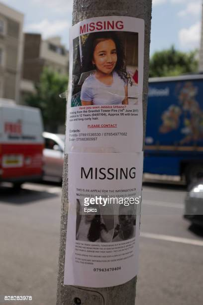 Missing people signs stuck to a lampost near to the site of Grenfell Tower North Kensington London England 79 people are presumed dead and dozens...