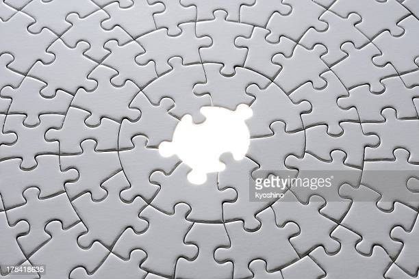 Missing piece of a blank puzzle with light from behind