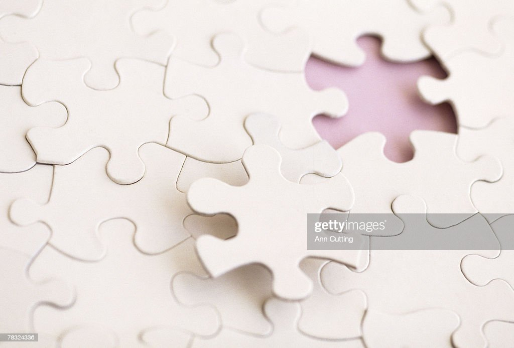 Missing piece of a puzzle : Stock Photo
