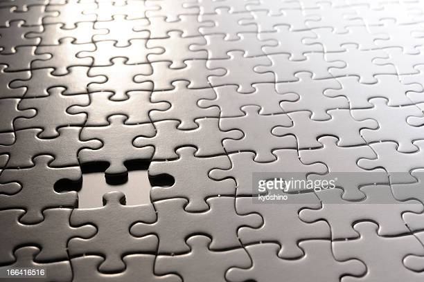 Missing piece of blank white Jigsaw puzzle