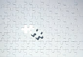 Missing piece on grey jigsaw puzzle
