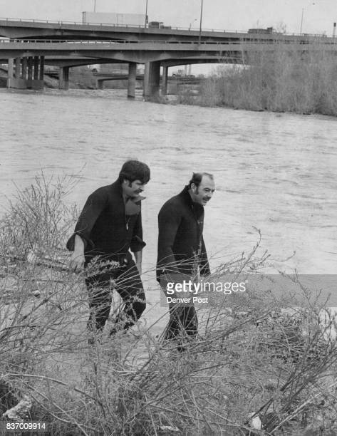 Missing Swimmer Sought Denver Fire Department divers Stan Campbell left and Jack Rogers search bank alongside the South Platte River near East 46th...
