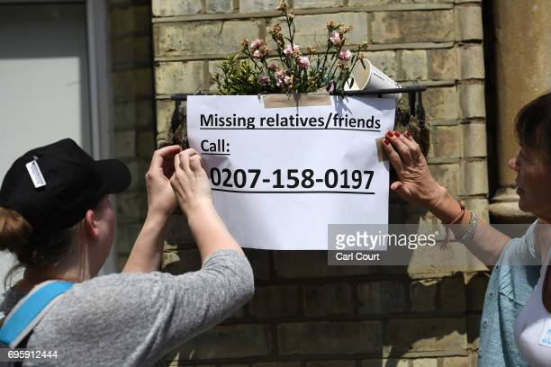A missings person notice is put up outside a church that has been converted into a community centre near the 24 storey residential Grenfell Tower...