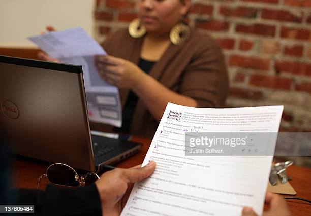 Mission Economic Development Agency worker Cynthia Valencia helps a client with with free tax preparations on January 27 2012 in San Francisco...