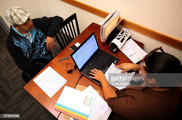 Mission Economic Development Agency worker Cynthia Valencia helps Juan Narvaez with free tax preparations on January 27 2012 in San Francisco...