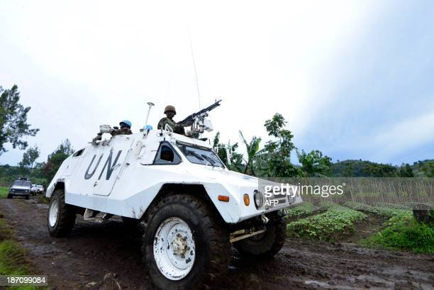 A UN mission in DR Congo armored personnel carrier patrols on November 5 2013 on Chanzu hill 80 kilometres north of regional capital Goma in the...