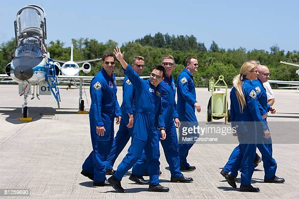 STS124 mission specialist Akihiko Hoshide of the Japanese Space Agency JAXA waves while walking with mission specialists Greg Chamitoff pilot Ken Ham...