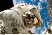 Mission specialist Piers J Sellers participates in the mission's third and final spacewalk July 13 2006 Sellers was on a 7hour 11minute walk...