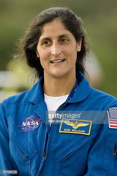 Mission specialist Sunita Williams addresses the media after arriving at the shuttle landing facility for the launch of Space Shuttle Discovery on...