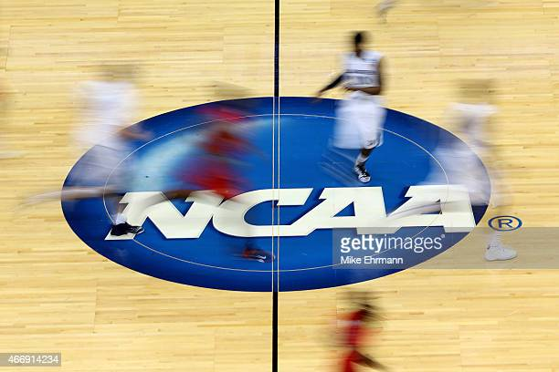 Mississippi Rebels and Xavier Musketeers players run by the logo at midcourt during the second round of the 2015 NCAA Men's Basketball Tournament at...