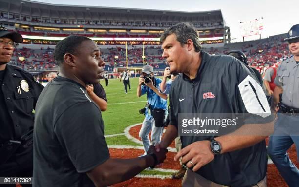 Mississippi Rebels interim coach Matt Luke shakes hands with Vanderbilt Commodores coach Derek Mason after a college football game on October 14 at...