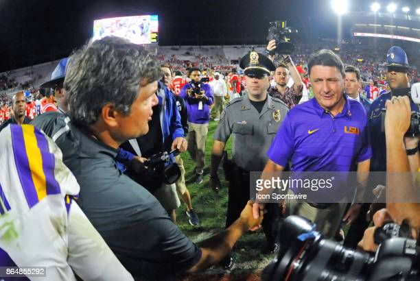 Mississippi Rebels interim coach Matt Luke shakes hands with LSU Tigers coach Ed Orgeron after a NCAA college football game on October 21 at...