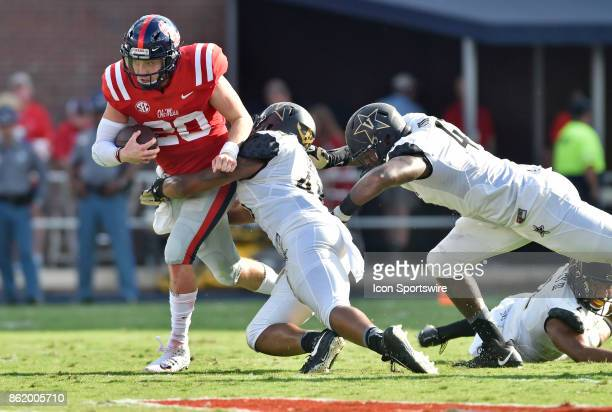 Mississippi Rebels quarterback Shea Patterson tries to break free from a Vanderbilt Commodores defender during the second quarter of a college...
