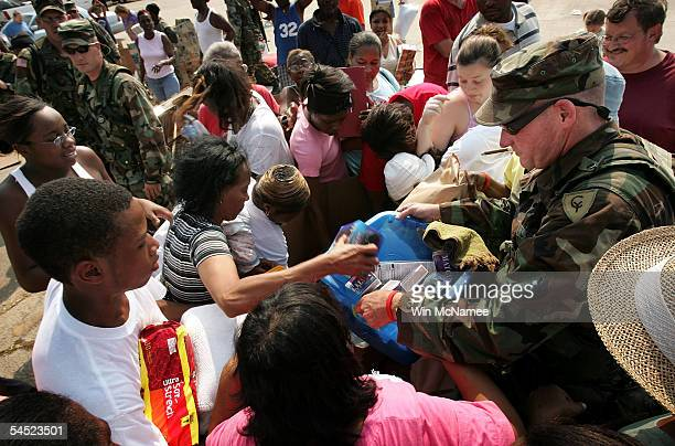 Mississippi residents scramble for donated goods handed out by members of the Alabama National Guard at a distribution center September 4 2005 in...