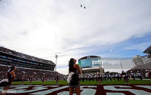 Mississippi State Bulldogs cheerleader watches a flyover before the start of an NCAA college football game against the Texas AM Aggies at Davis Wade...