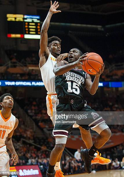 Mississippi State Bulldogs guard IJ Ready shooting with Tennessee Volunteers guard Jordan Bone defending during a game between the Mississippi State...