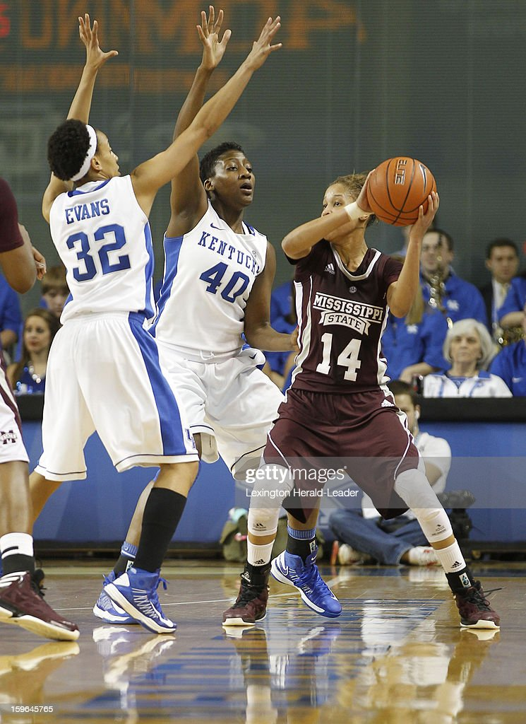 Mississippi State Bulldogs guard Kendra Grant (14) was pressured by Kentucky Wildcats guard Kastine Evans (32), Brittany Henderson (40) during a women's college basketball game at Rupp Arena on Thursday, January 17, 2013 in Lexington, Kentucky.
