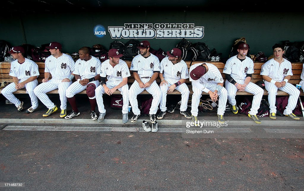Mississippi State Bulldogs players sit in the dugout before playing the UCLA Bruins during game one of the College World Series Finals on June 24, 2013 at TD Ameritrade Park in Omaha, Nebraska. UCLA won 3-1.