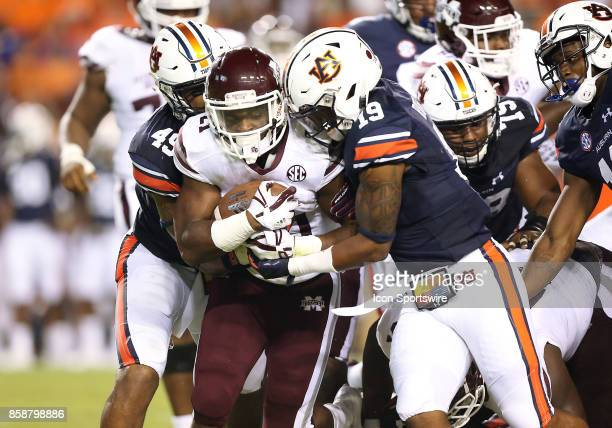 Mississippi State Bulldogs running back Nick Gibson is tackled by Auburn Tigers defensive back Nick Ruffin during a football game between the Auburn...