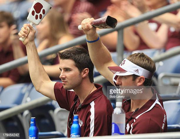 Mississippi State Bulldogs suppporters ring cowbells as the Bulldogs take the field to play the Oklahoma State Cowboys during the Advocare Texas...