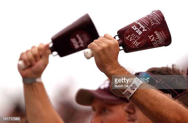 Mississippi State fans wave cowbells in the first quarter of a NCAA college football game against Auburn on September 8 2012 at Davis Wade Stadium in...