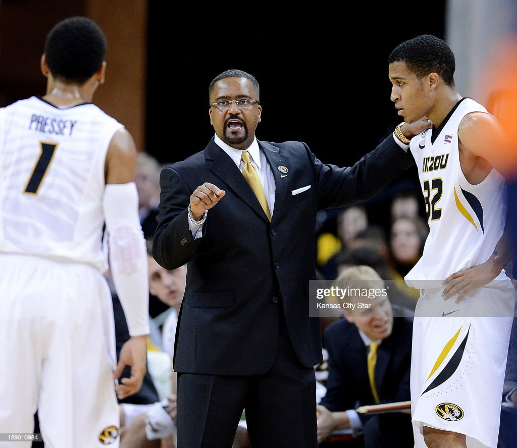 Missouri coach Frank Haith huddles up with Phil Pressey (1) and Jabari Brown (32) during the first half against Bucknell at Mizzou Arena in Columbia, Missouri, Saturday, January 5, 2013. Missouri beat Bucknell, 66-64.