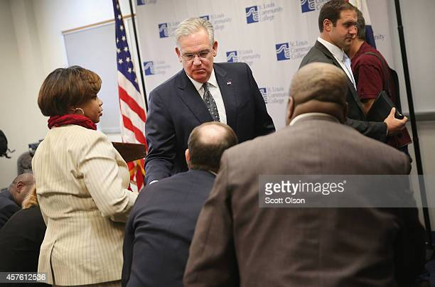 Missouri Governor Jay Nixon greets guests at a press conference where he announced a plan to create a commission to address issues raised by recent...