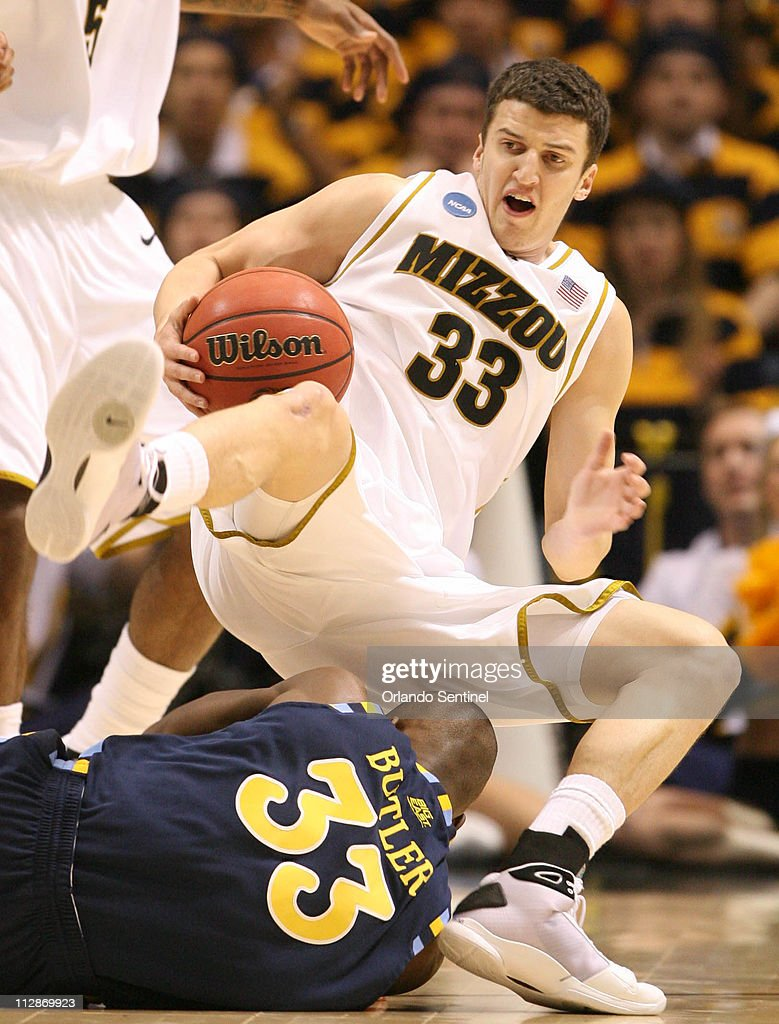 Missouri guard Matt Lawrence (33) is tripped up by Marquette's Jimmy Butler (33) during the first half of their game in the second round of the NCAA men's college basketball tournament at Taco Bell Arena in Boise, ID Sunday, March 22, 2009.