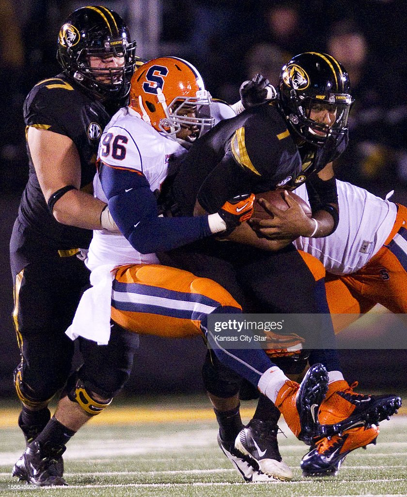 Missouri offensive linesman Evan Boehm (77) tries to pull Syracuse Ornge defensive tackle Jay Bromley (96) off of Missouri quarterback James Franklin (1) as Franklin was sacked in the second quarter at Faurot Field on Saturday, November 17, 2012, in Columbia, Missouri.